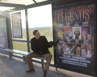 Dean with one of the many tram stop Legends posters!